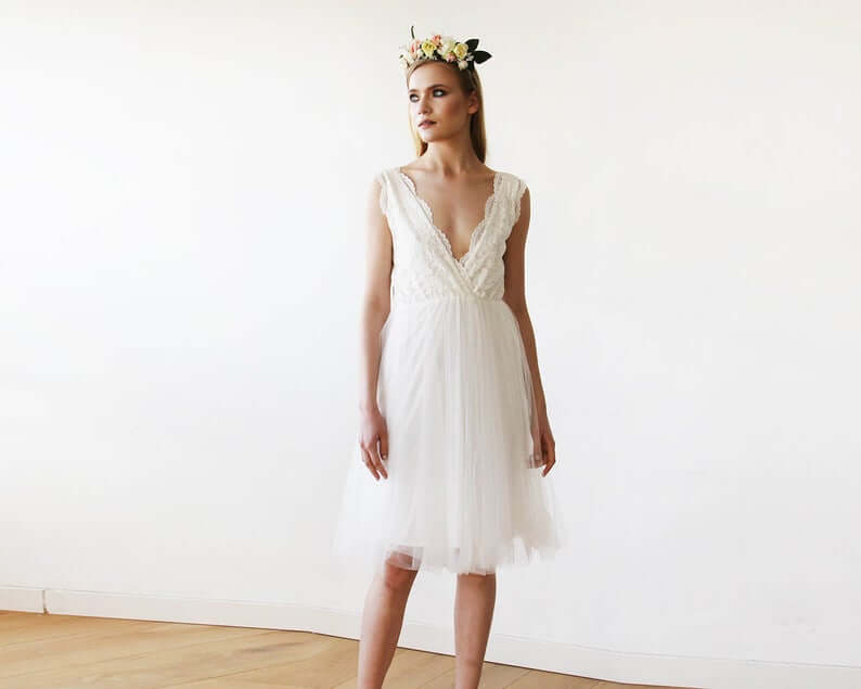 Bride wearing short tulle wedding dress