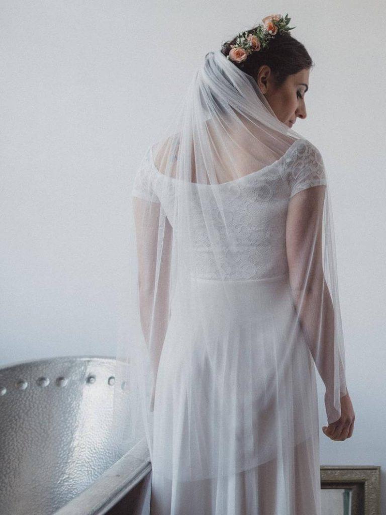 Bride wearing silk tulle bridal veil