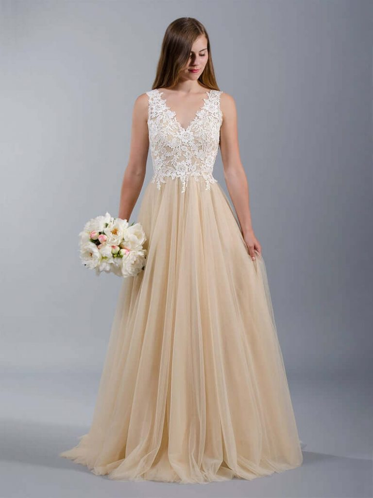 Bride in sleeveless wedding gown