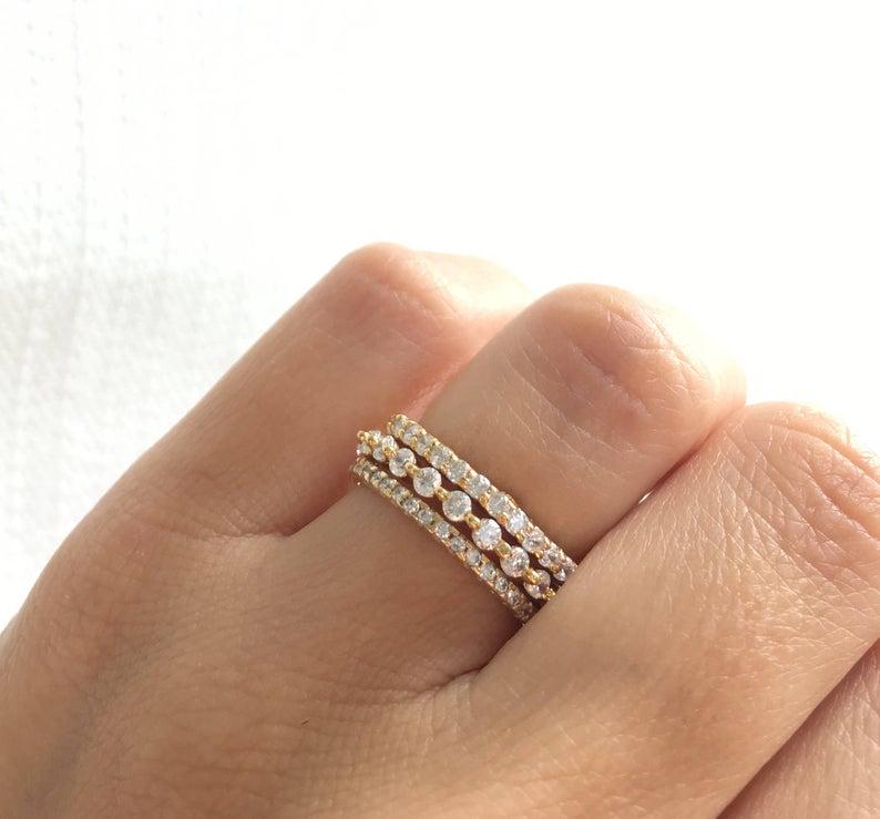 Stacking wedding rings on finger closeup