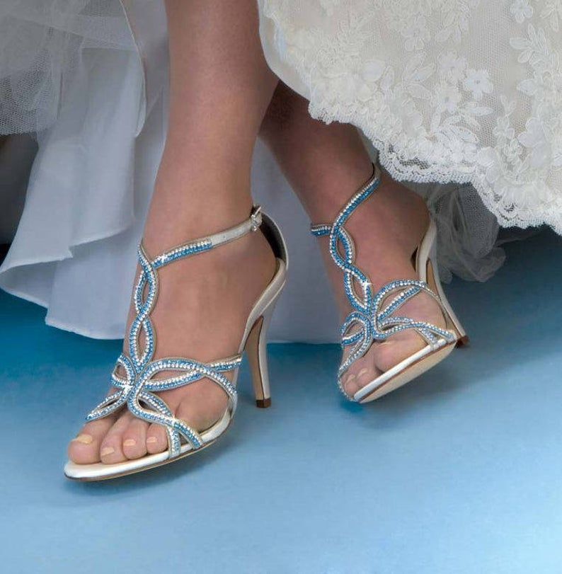 Bride wearing strap wedding shoes
