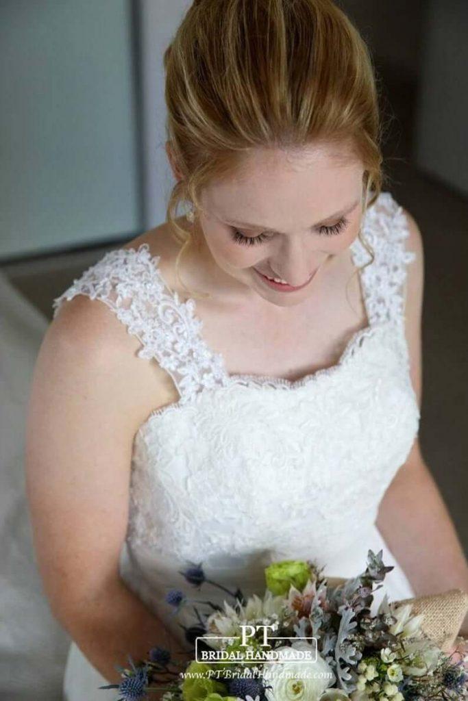 Bride wearing strap wedding gown
