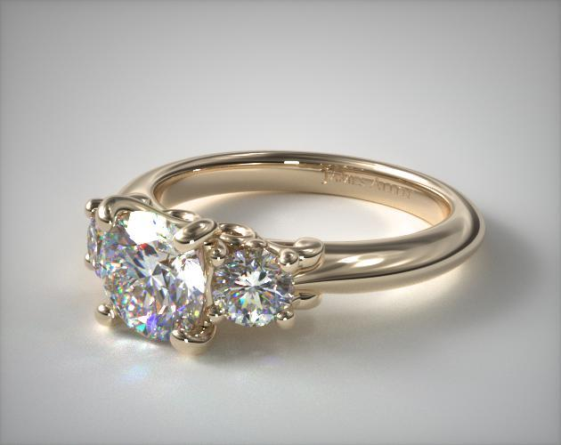 Traditional three stone ring in rose gold
