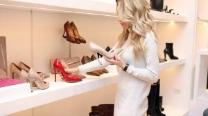Bride deciding on her wedding shoes