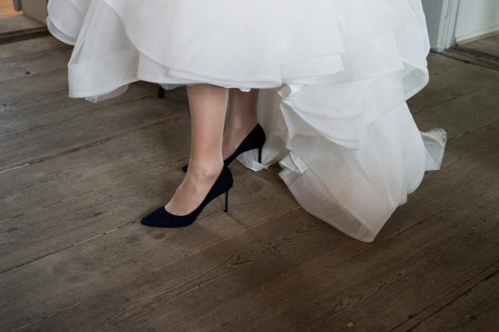 Bride wearing black wedding stilettos