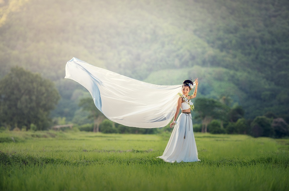 Bride in white dress outdoors