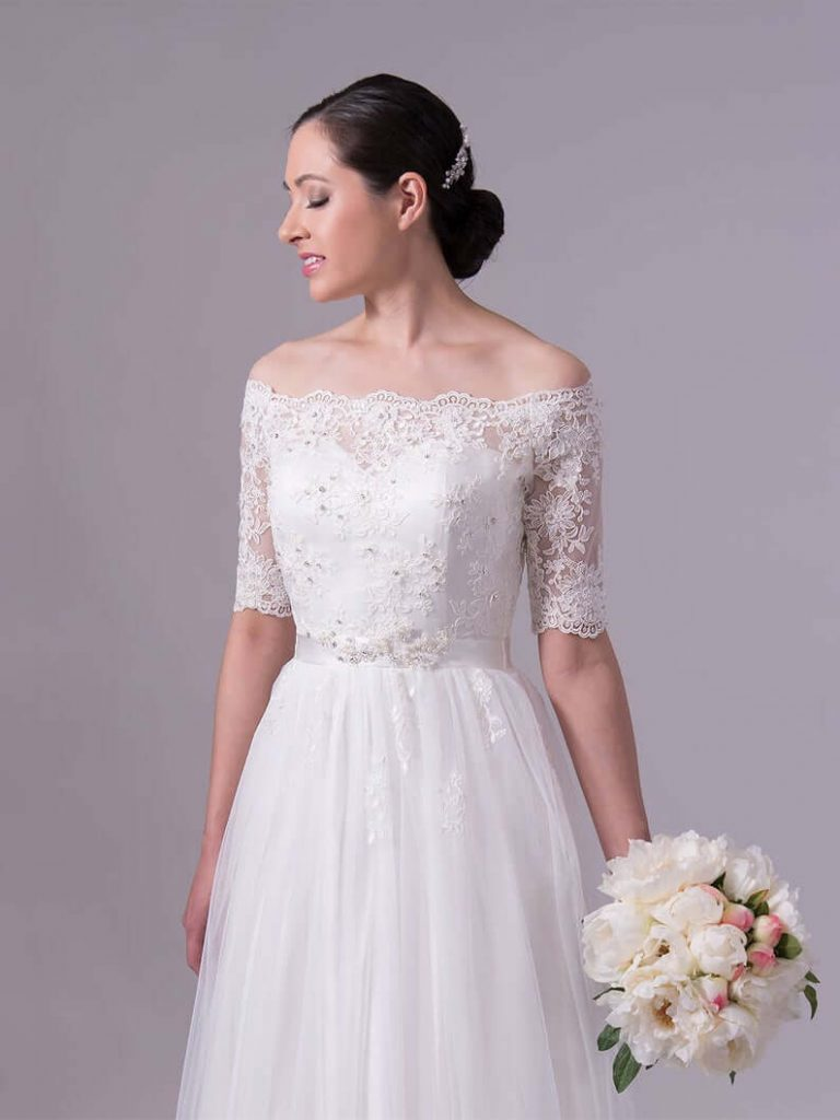 Bride wearing wedding dress with alencon lace