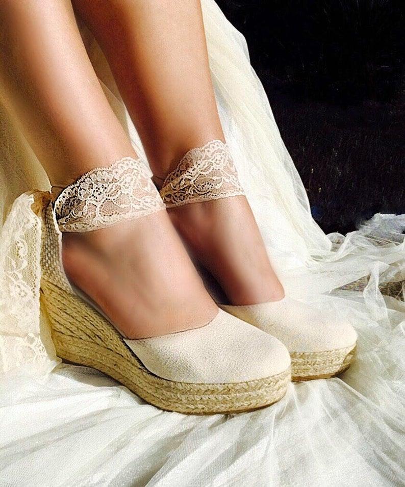 Bride wearing wedding wedge
