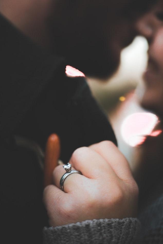 Girl wearing lab created diamond engagement ring