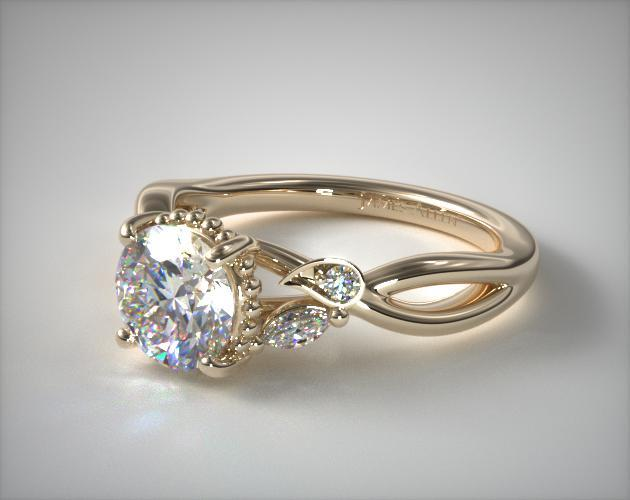 Yellow gold engagement ring with round diamond