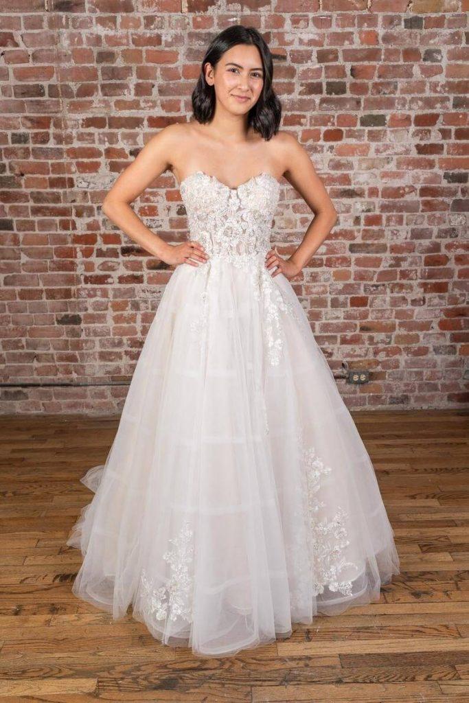 Bride wearing white sweetheart neckline wedding gown
