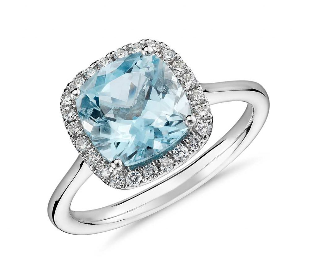 Aquamarine engagement ring in white gold halo setting