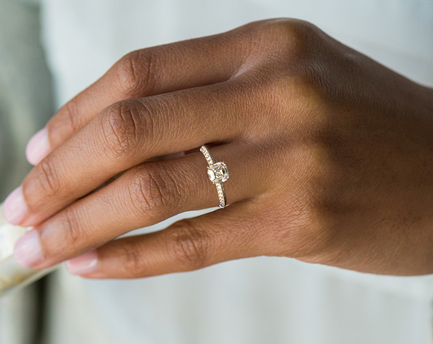 Bride wearing asscher engagement ring