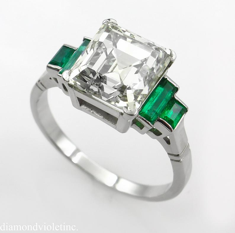 Asscher shape diamond with green emerald engagement ring