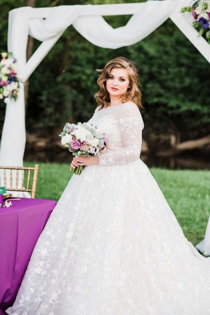 Plus size bride wearing ballgown wedding dress