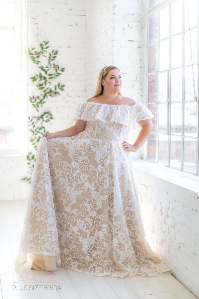 Beautiful plus sized bride wearing off-shoulder wedding dress