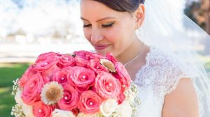 Second time bride wearing dress holding flowers