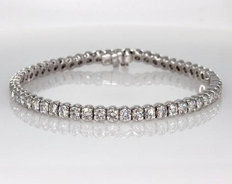Bezel setting diamond tennis bracelet worn on wedding day