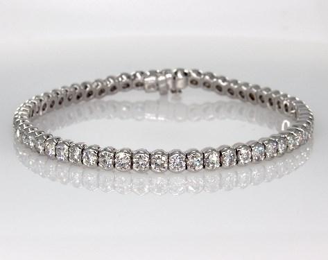 Bezel setting diamond tennis bracelet worn on wedding day