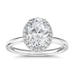 Oval cut engagement ring in white gold 8 prong setting