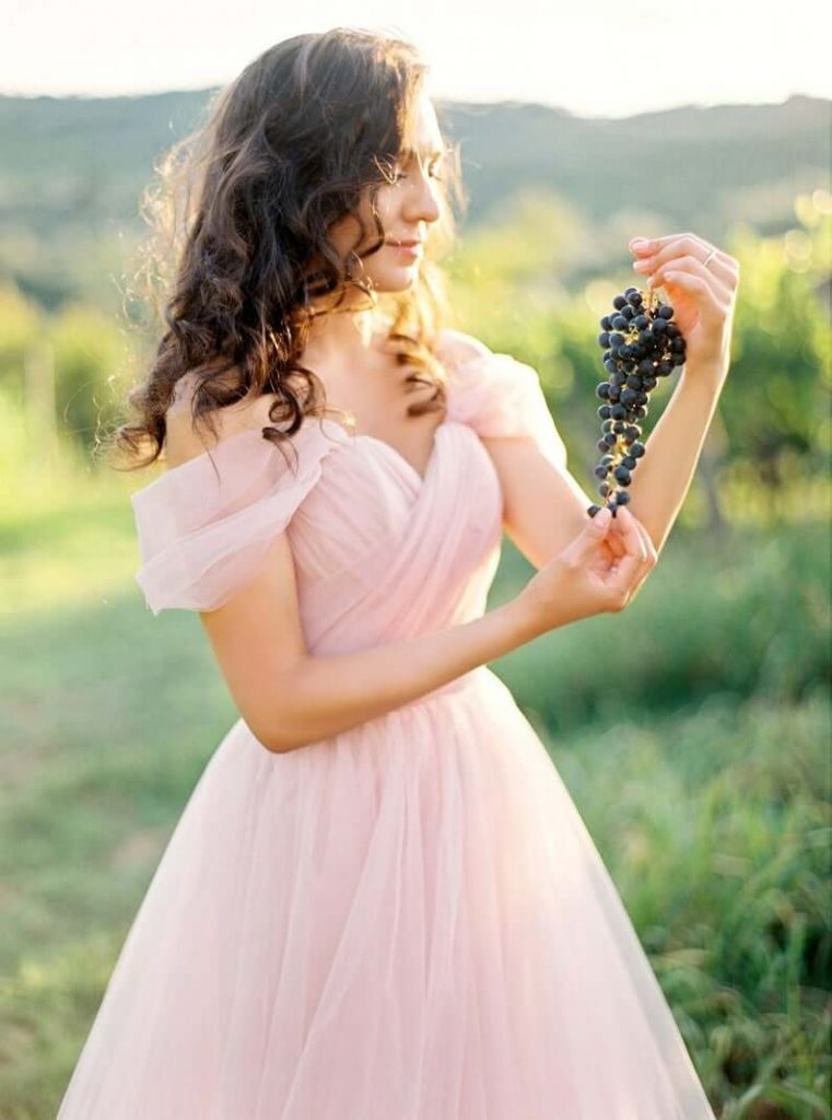 Bride wearing blush wedding dress