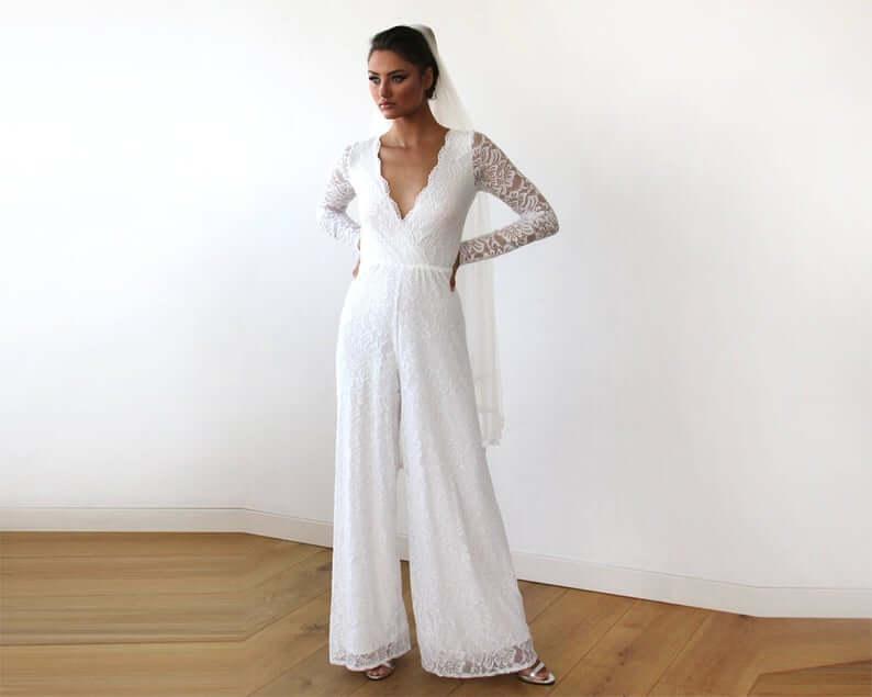 Bride wearing white bohemian bridal jumpsuit