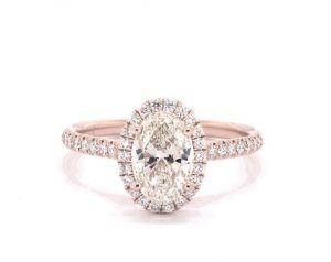 Oval cut diamond engagement ring with bow tie