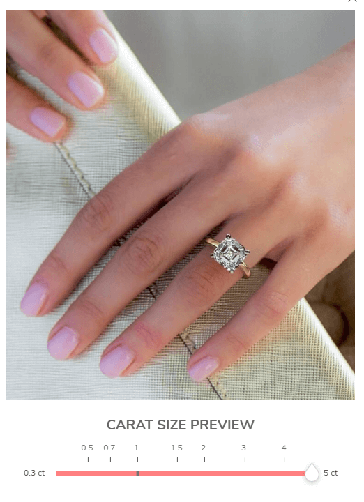 5 carat asscher engagement ring on girl's finger