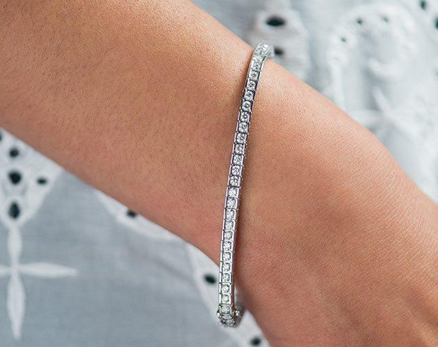 channel set tennis bracelet on bride's hand