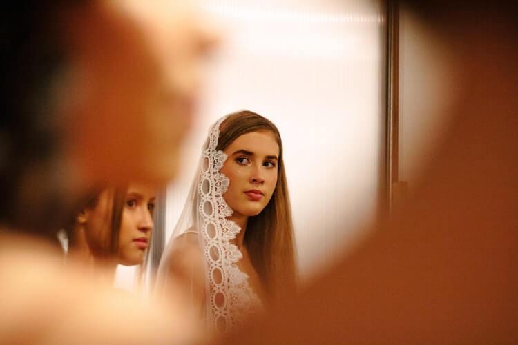 Bride wearing her wedding veil
