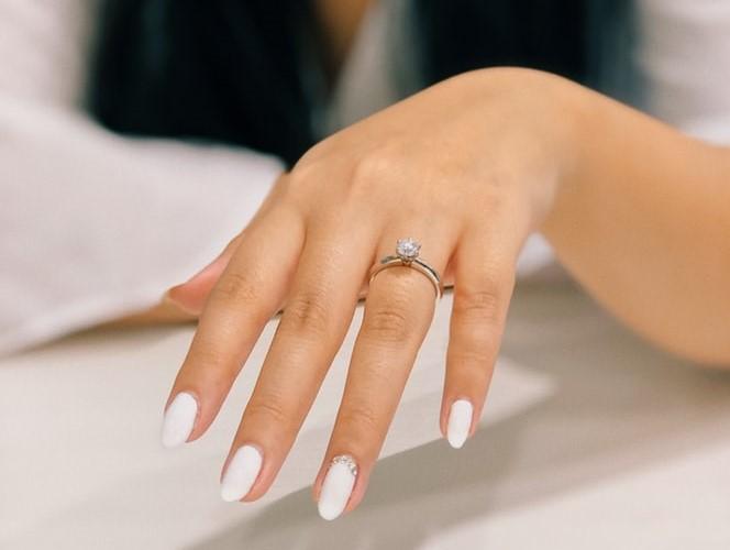 Girl wearing cubic zirconia engagement ring