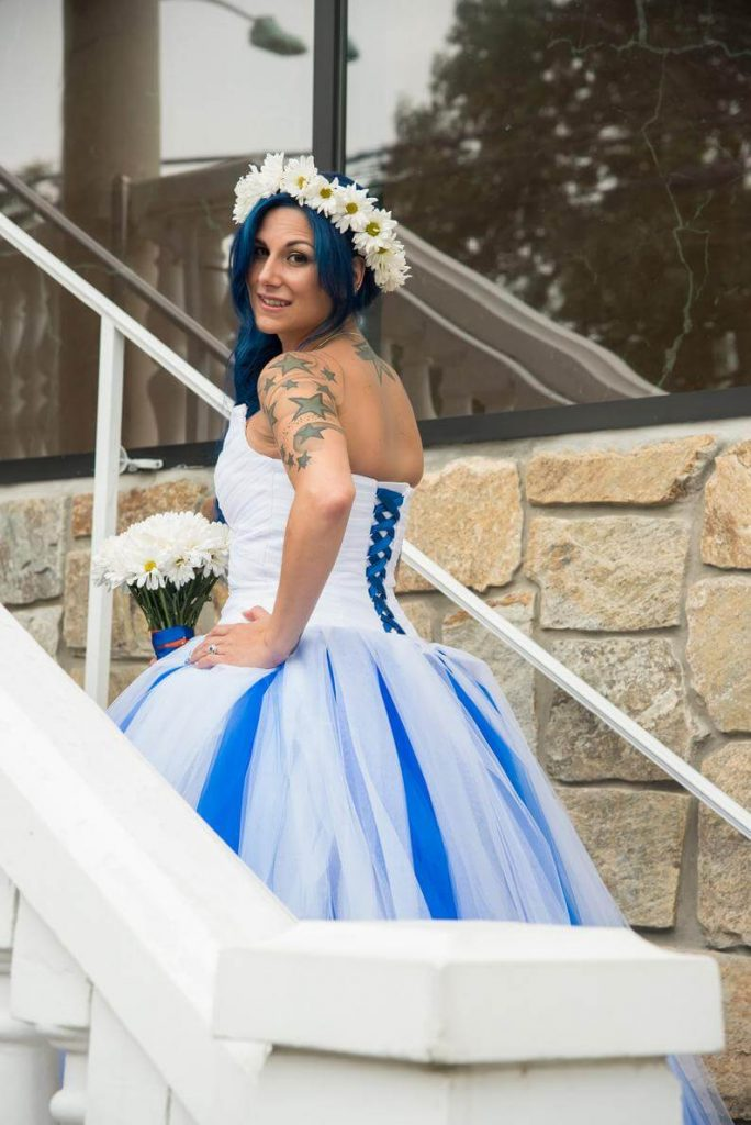 Bride wearing white and blue wedding dress