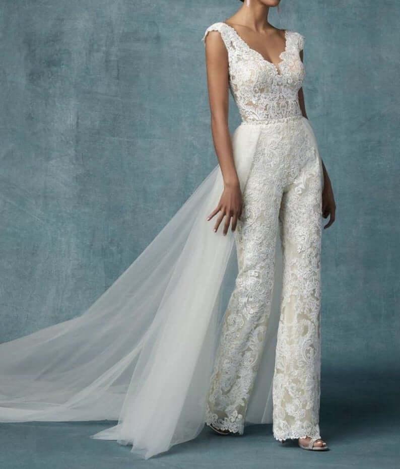 Bride with detachable bridal jumpsuit train