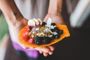 blackberries and blueberries on papaya