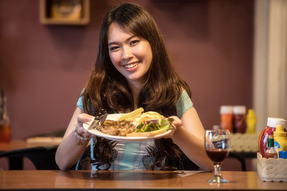 Girl showing her food plate