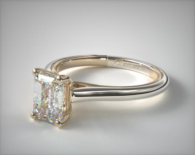 Emerald cut solitaire engagement ring in white gold close up