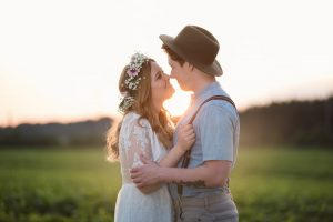 Bride and groom kissing in sunset