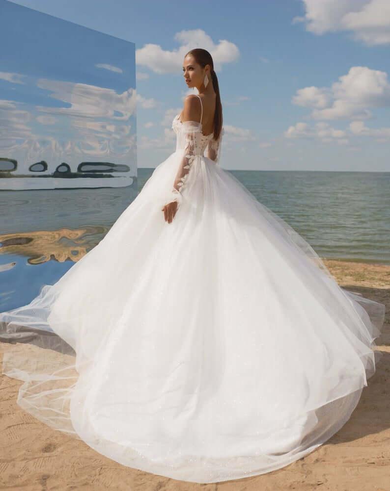 Bride in white dress at beach wedding