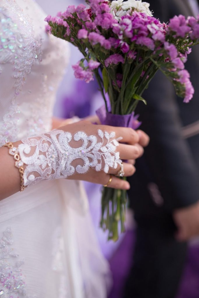 Girl wearing bridal gloves