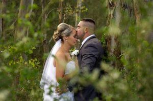 Groom bride kissing