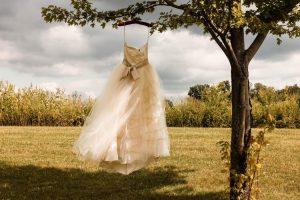 Wedding dress hanging from tree