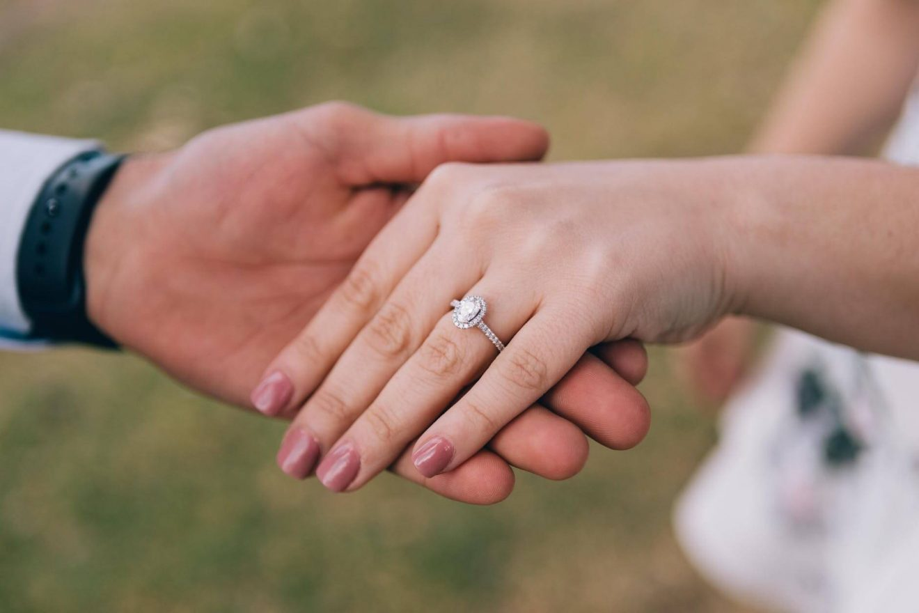 Bride wearing lab created diamond engagement ring