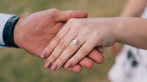 Bride wearing lab created diamond engagement ring