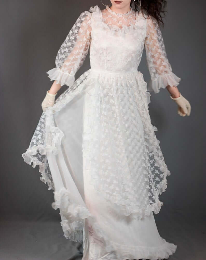 Bride wearing lace ruffle sleeve wedding dress