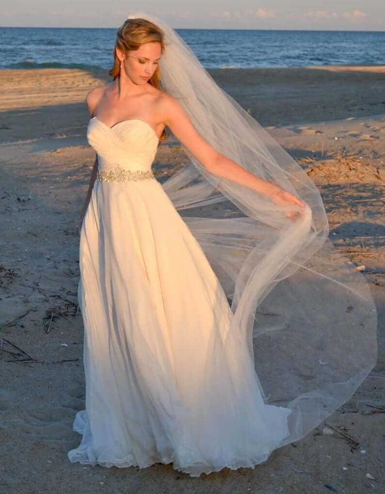 Bride wearing long veil