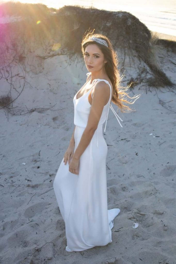Bride wearing minimalist beach wedding dress