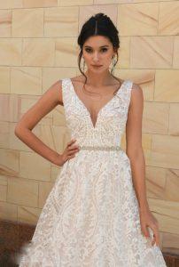 Bride wearing white natural-medium waistline wedding dress