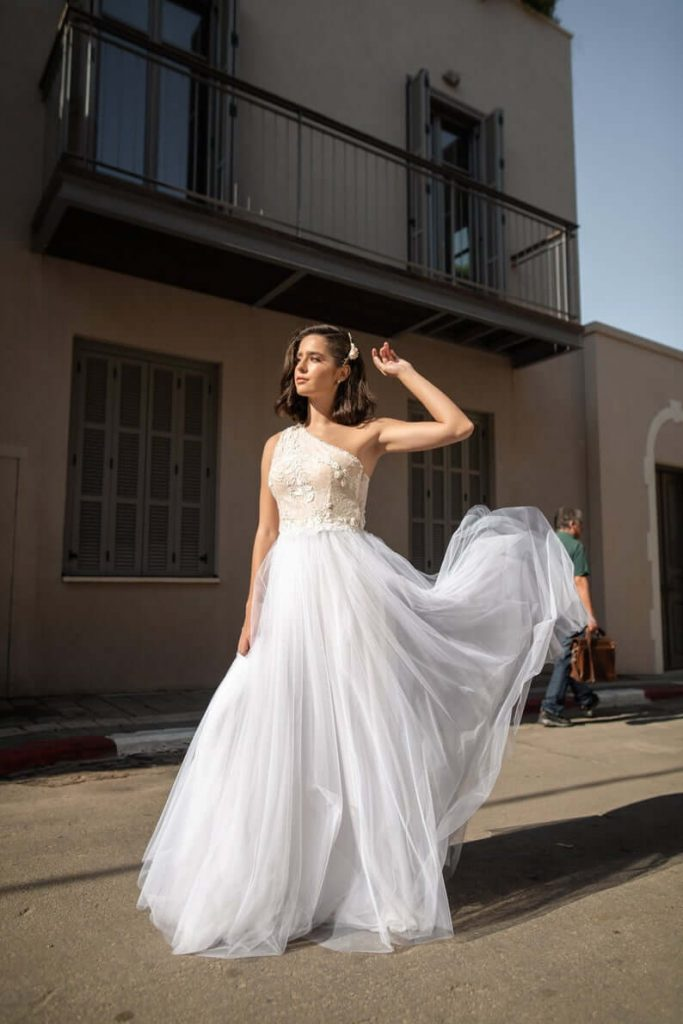 Bride wearing one shoulder wedding dress