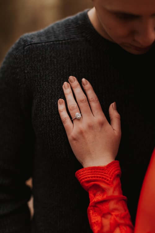 Bride wearing oval shape engagement ring