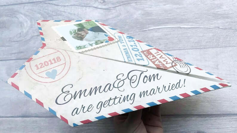 Paper plane save the dates